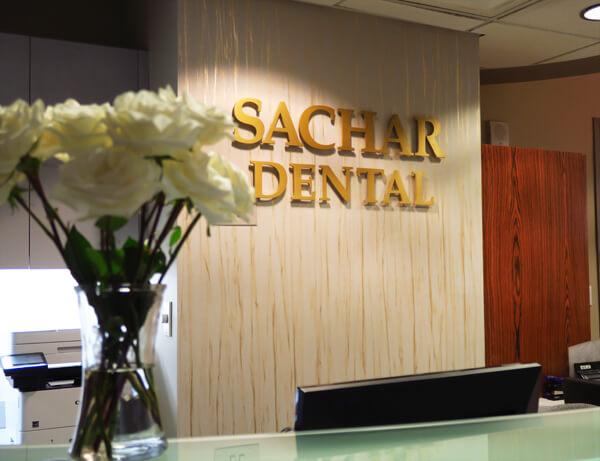 Dentist NYC - Sachar dental NYC logo over the front desk. Sachar dental NYC